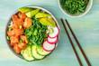 Hawaiian salmon poke salad with wakame and copy space
