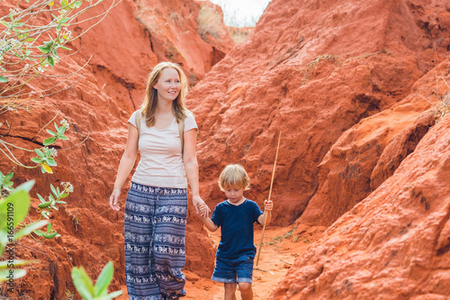 Mother and son travelers in red canyon near Mui Ne, southern Vietnam. Traveling with children concept