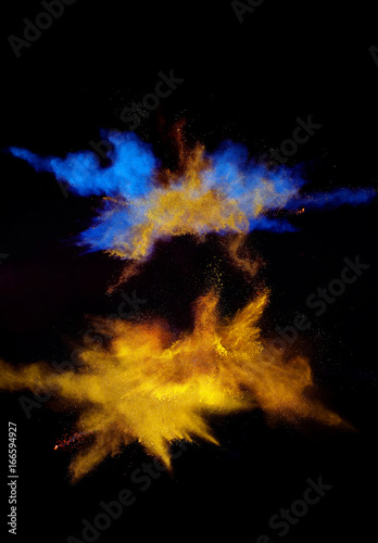 Multi cloud blasting  powder paint and flour combined, explode in front of a black background to give off fantastic multi color forms. - 166594927