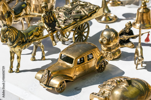 closeup of mix brass retro cars and horses for decoration плакат