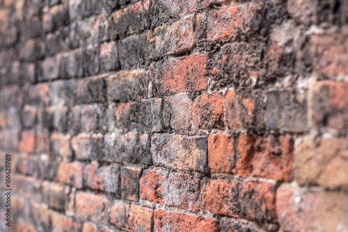 Deurstickers Baksteen muur Red brick wall, selective focus