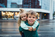 outdoor portrait hugging happy brother and sister
