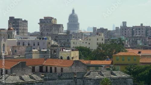 A high angle dolly establishing shot of the capitol dome in the old town section of Havana, Cuba. Shot in 5K.