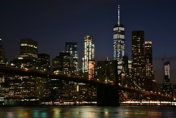 The Brooklyn Bridge and skyline of downtown Manhattan from Brooklyn at night.
