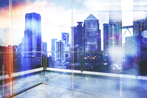 View of urban cityscape from empty business office with glass partition .