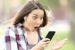 Amazed girl listening on line music