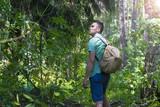 A man walks in the woods. A traveler, a tourist. Summer. Autumn. - 166673700