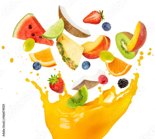 fruit salad falling into splashing orange juice