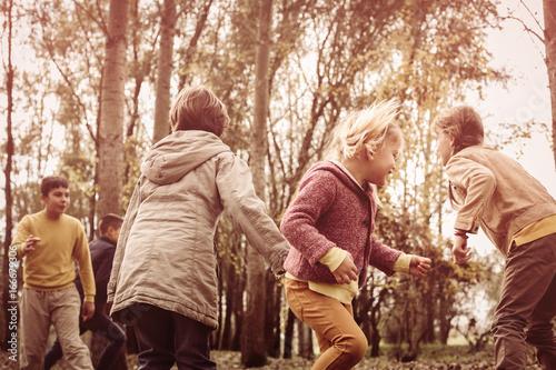 Papiers peints Orange eclat Children playing in the park.