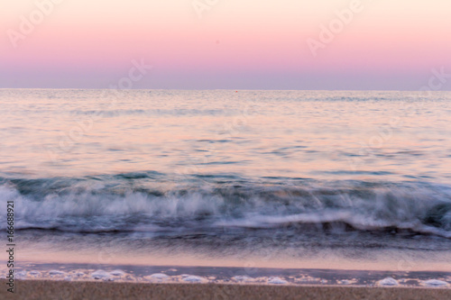 Deurstickers Lichtroze wave at sunrise