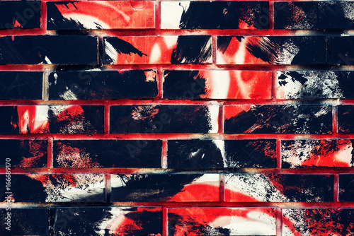 Brick wall surface with grunge paint brush strokes
