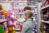Two sisters in   toy store - 166689301