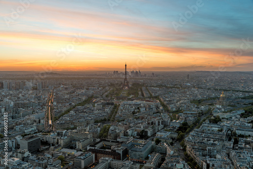 Aerial view of Paris and Eiffel tower at sunset in Paris, France.