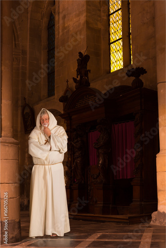 Monk in old church