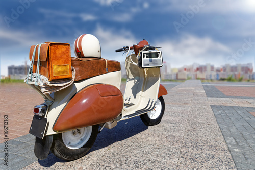 Foto op Canvas Scooter Vintage retro motor scooter on a background of urban houses in the distance. Blurred background and backlight of sun shining. Copyspace.