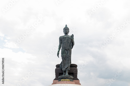 Big Buddha Statue with cloudy sky in Thailand