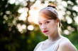 Sunlit Cute Girl in a White Summer Dress