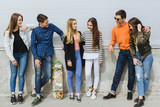 Summer holidays and teenage concept - group of smiling teenagers with skateboard hanging out outside. - 166732127