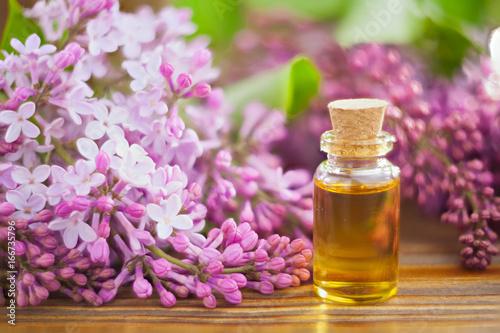 Essence of flowers on table in beautiful glass jar © solstizia