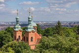 View of the tower of the church of St. Lawrence Church on Petrin hill in Prague, Czech Republic.