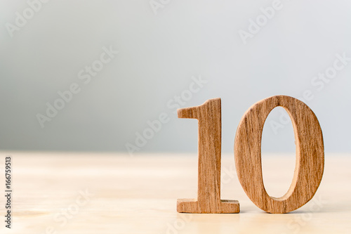 Wood sign number ten on table with copy space