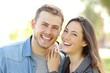 Quadro Couple posing with perfect smile and white teeth