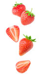 Isolated strawberries. Falling strawberry fruits whole and cut in half isolated on white background with clipping path - 166786945