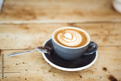 Sticker Cappuccino on wooden table