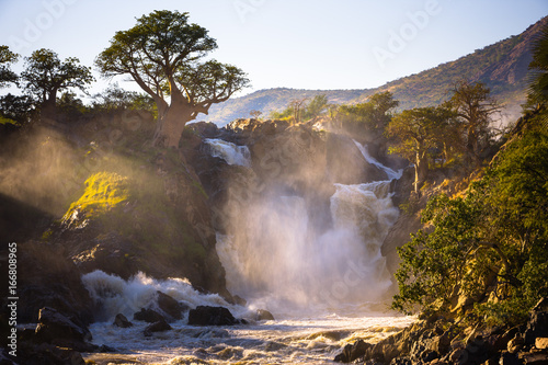 Foto op Canvas Baobab Misty sunrise on Epupa falls - Kunene river - Namibia - Angola border