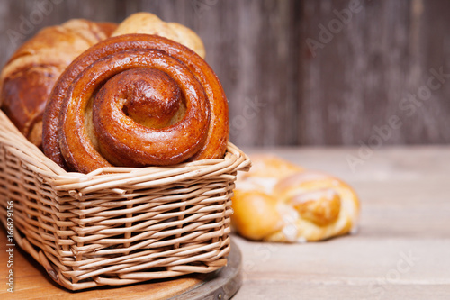 Fresh baked homemade buns and rolls in a wicker basket