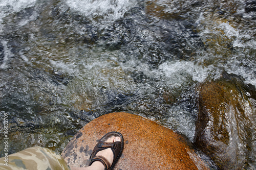 Stand on the stone in a mountain river. Poster