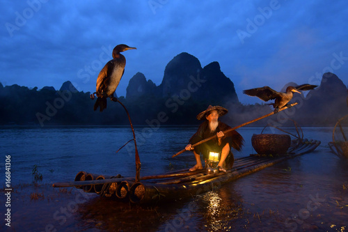 Staande foto Guilin Fisherman of Guilin, Li River and Karst mountains during the blue hour of dawn,Guangxi China