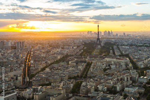 Wall mural Sunset view of city skyline with Eiffel Tower in Paris, France