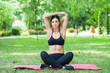 young fitness woman exercise in a park in summer