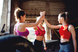 Smiling fitness motivated women doing high five.