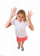 fun high angle full body portrait of teenage girl making a funny face,playing with her hands up for joke,isolated