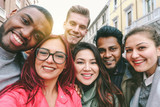Happy friends from diverse cultures and races taking selfie with back lighting - 166864720
