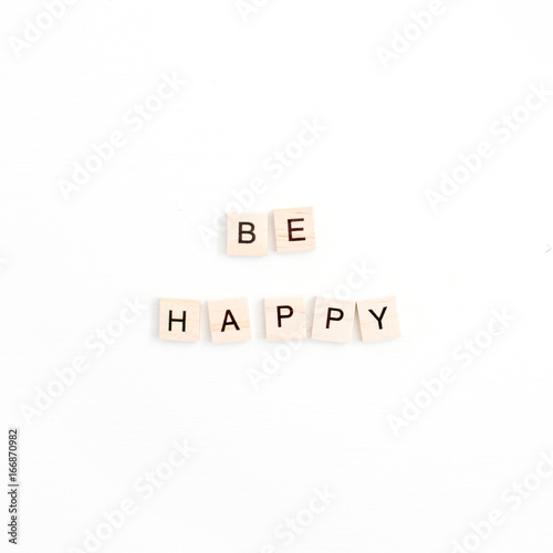 Quote Be Happy with wooden tiles on white background Poster