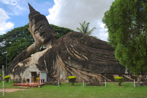 View at the reclining Buddha statue in Buddha park near Vientiane, Laos.