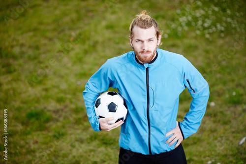 Confident soccer coach in sportswear