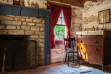 Rustic Cabin Interioir with Dresser, Chair, Fireplace and Window - 166892940