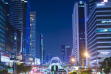 Bangkok business district at night with office buildings.