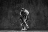 Young beautiful dancer is posing in studio - 166902548
