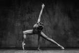 Young beautiful dancer is posing in studio - 166902562