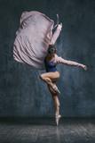 Young beautiful dancer is posing in studio - 166902783