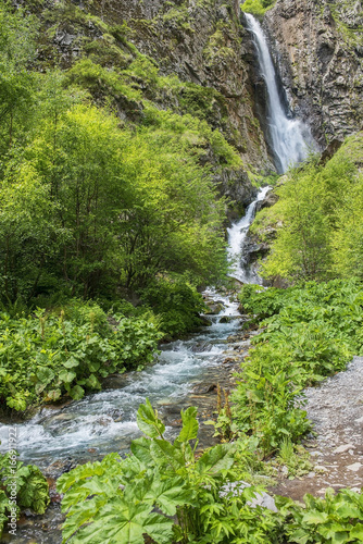 landscape with a waterfall  in the Caucasus Mountains, Georgia - 166911922
