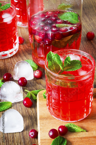 Fresh cranberry juice with mint leaves and ice cubes, selective focus