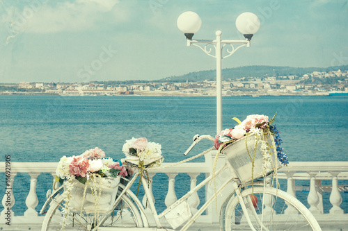 Vintage Bicycle With Basket On Waterfront By Sea In Summer