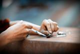 Heroin drug preparation with lighter - 166947573