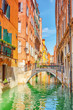 Views of the most beautiful channel of Venice, narrow streets, houses .Italy.